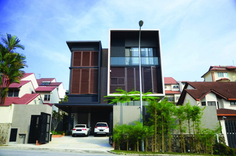 The house facade functions as both aesthetic and shading element