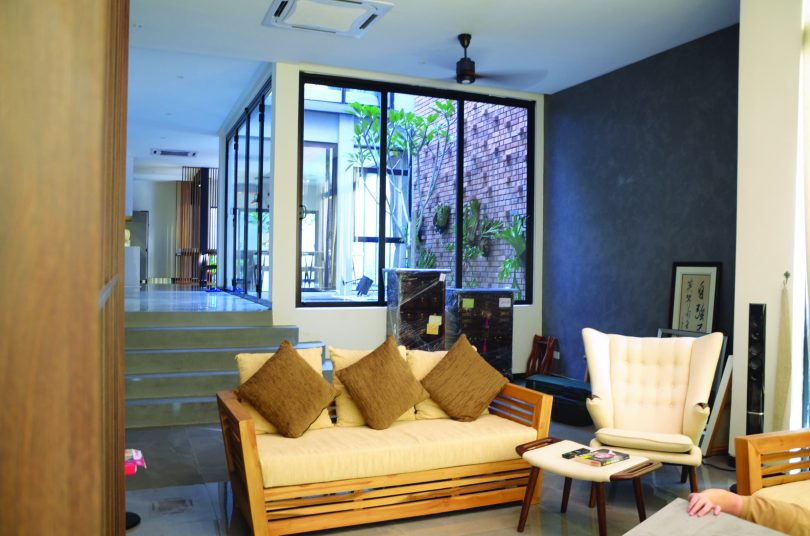 Living room with the courtyard in the background