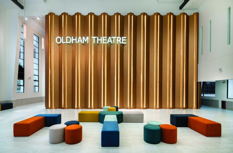 Entrance to the theatre made from aluminium bronze panels